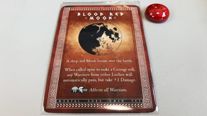 Omenkarte 'Blutroter Mond' mit rotem Kieselstein